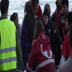 LESVOS, GREECE - NOV 5, 2015: Refugees leave rubber dinghy near the shore Stock Footage