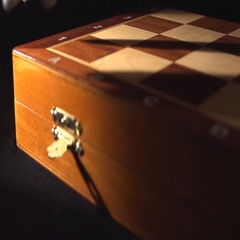 Hand opens a box with chess pieces Stock Footage