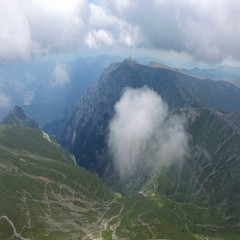 Bucegi mountains, Romania, aerial flight from clouds Stock Footage