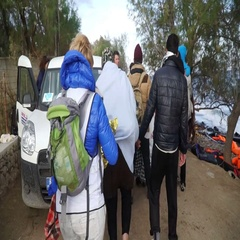 LESVOS, GREECE - NOV 5, 2015: Volunteers escorted the refugees to the car Stock Footage