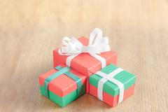 Gift box on wood table Stock Photos
