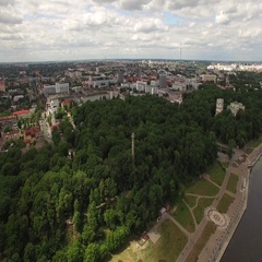Fly over city buildings and park at river Sozh with embankment in Gomel Belarus Stock Footage