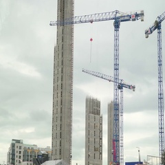 Two big cranes on an ongoing building construction Stock Footage