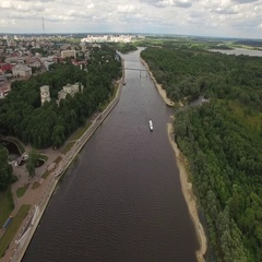 Gomel Belarus aerial 4K fly over river Sozh top view of cruise boat moving above Stock Footage