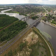 Fly over cars moving on road bridge over river in Homel Belarus aerial view 4K Stock Footage