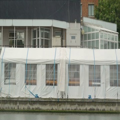 White tents floating in a river in Dublin Stock Footage