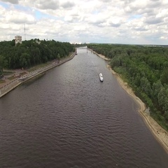 Fly over river in Gomel Belarus aerial 4K cruise boat and city embankment park Stock Footage