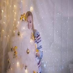 Christmas presents. Emotional pretty girl near christmas shows present, excited Stock Footage