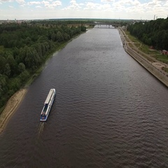 Homel river Belarus aerial 4K HD. Fly over Sozh waters with cruise boat moving Stock Footage