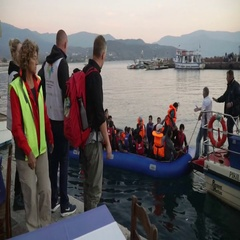 LESVOS, GREECE - NOV 5, 2015: Refugees who were rescued in the sea. Towing to Stock Footage