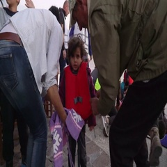 LESVOS, GREECE - NOV 5, 2015: Refugees who were rescued in the sea. Children Stock Footage