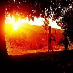 Kids playing, mountain range sunset Stock Footage