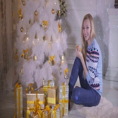 Girl putting a toy on a new year tree, preparing for Christmas Family Stock Footage