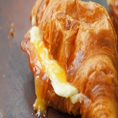 Fresh ham and cheese croissant Stock Footage