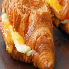Fresh baked ham and cheese croissant Stock Footage