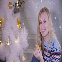 Cute young female decorating Christmas tree. New year coming concept Stock Footage