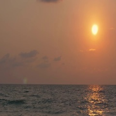 Sunset of sun setting over Andaman sea in the Indian ocean Stock Footage