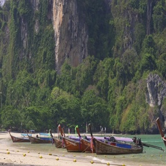 Tropical beach with wooden boats on sea coast at Krabi, Thailand Stock Footage
