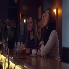 Group of friends drink coffee in a modern cafe. 4K UHD RAW edited footage Stock Footage