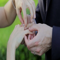 Bride and Groom Hands and Wedding Diamond Rings Stock Footage