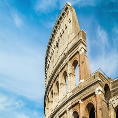 Close-up timelapse of clouds over the famous ancient Colosseum Amphitheater. Stock Footage