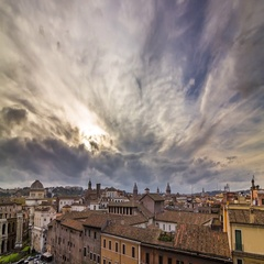 Evening timelapse of clouds over the old roman roofs and Vatican Stock Footage
