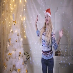 Beautiful girl smiling to Camera, Dancing near Christmas Tree. New Year, Eve Stock Footage
