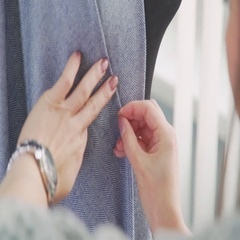 Seamstress clothing stabs safety pins and make the stitches Stock Footage