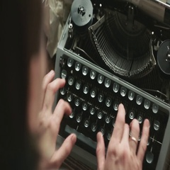 Person typing on old typewriter Stock Footage
