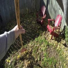First person view man raking leaves Stock Footage