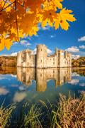 Historic Bodiam Castle with autumn leaves in East Sussex, England Stock Photos