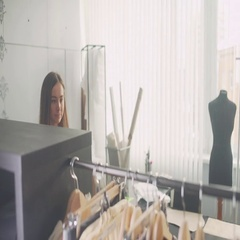 Young woman shopping for clothes fashion designer browsing wardrobe Stock Footage