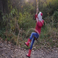 Little girl in nature park unexpectedly falls from a swing on ground confused Stock Footage