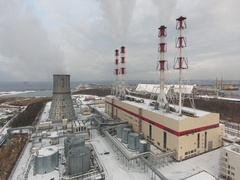 Aerial drone video of a natural gas power plant. Power plant tubes throw out smo Stock Footage