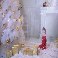 Baby near a Christmas tree with a gift explore New year presents and tree Stock Footage