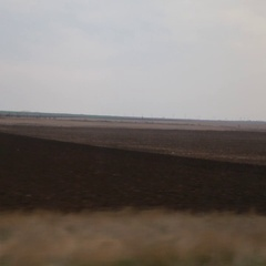 Driving along country fields Stock Footage