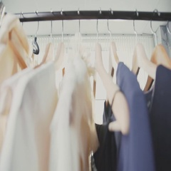 Attractive fashion designer working on a dress in her studio Stock Footage
