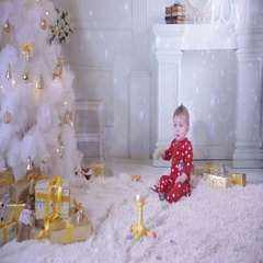 1 year baby near the Christmas tree, eating bagel Stock Footage