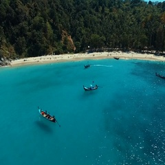 Aerial: Long tail boats on the beautiful beach. Stock Footage