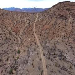 Aerial of desert landscape bird-eye view flying over desert road 4k Stock Footage