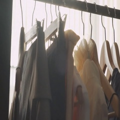 Close-up: a hanger for clothing. Clothes hangers. Designer clothing Stock Footage