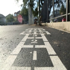 Hopscotch painted on playground, slider Stock Footage