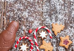 Festive Christmas wooden background with sweets and decoration Stock Photos