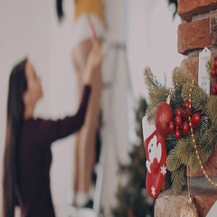 Girls decorate the apartament for Christmas Stock Footage