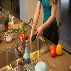 Young woman washing vegetables Stock Footage