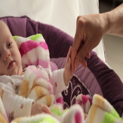 Baby rocking in a cradle Stock Footage