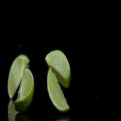 Lime splits into segments on a black background Stock Footage