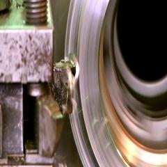 Cutter lathe removes metal shavings.  Macro Stock Footage