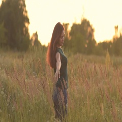 Stroking her long hair and looking at the sunset. Stock Footage