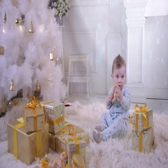 Baby child near the Christmas tree, eating bagel Stock Footage